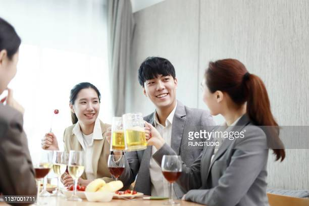 business people toasting with beer after work - 仕事後 ストックフォトと画像