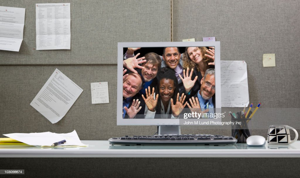 Business people trapped in computer monitor : Bildbanksbilder