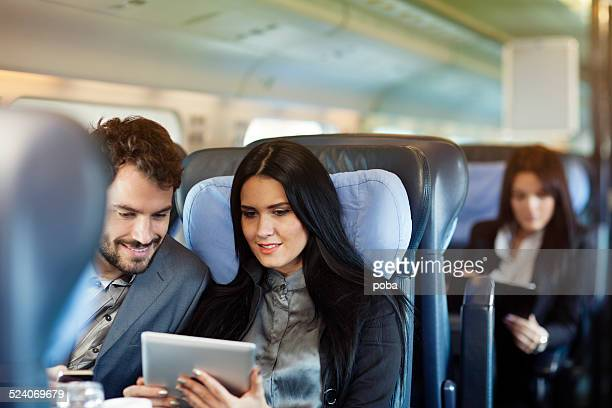 business people travel by train