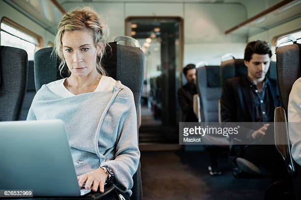 Business people traveling in train
