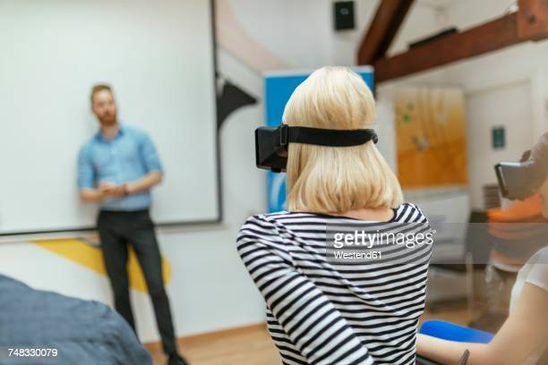Business people trying out VR glasses