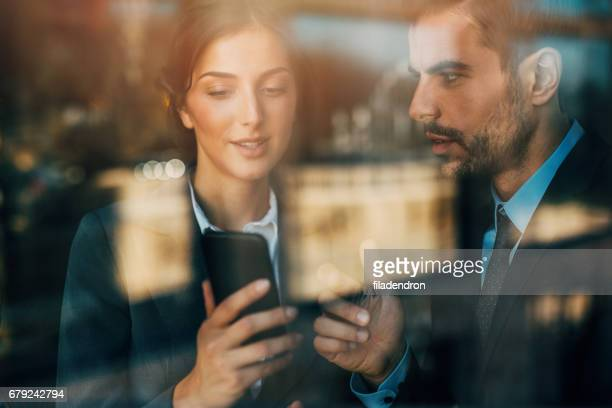 Business people using a smart phone