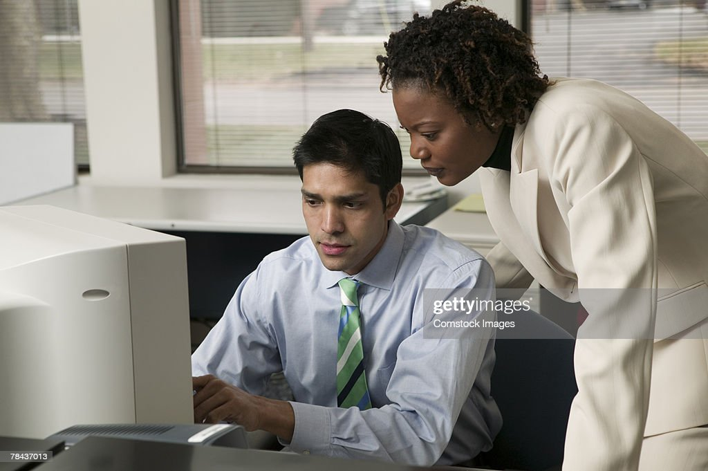 Business people using computer : Stockfoto