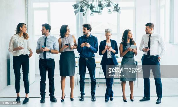 business people using digital devices - full suit stock pictures, royalty-free photos & images
