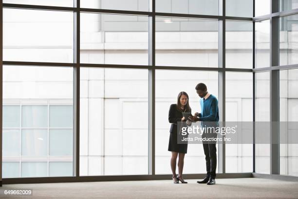 Business people using digital tablet in empty office