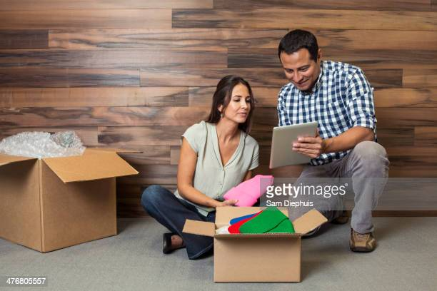 business people using digital tablet in new office - loader reading stock pictures, royalty-free photos & images
