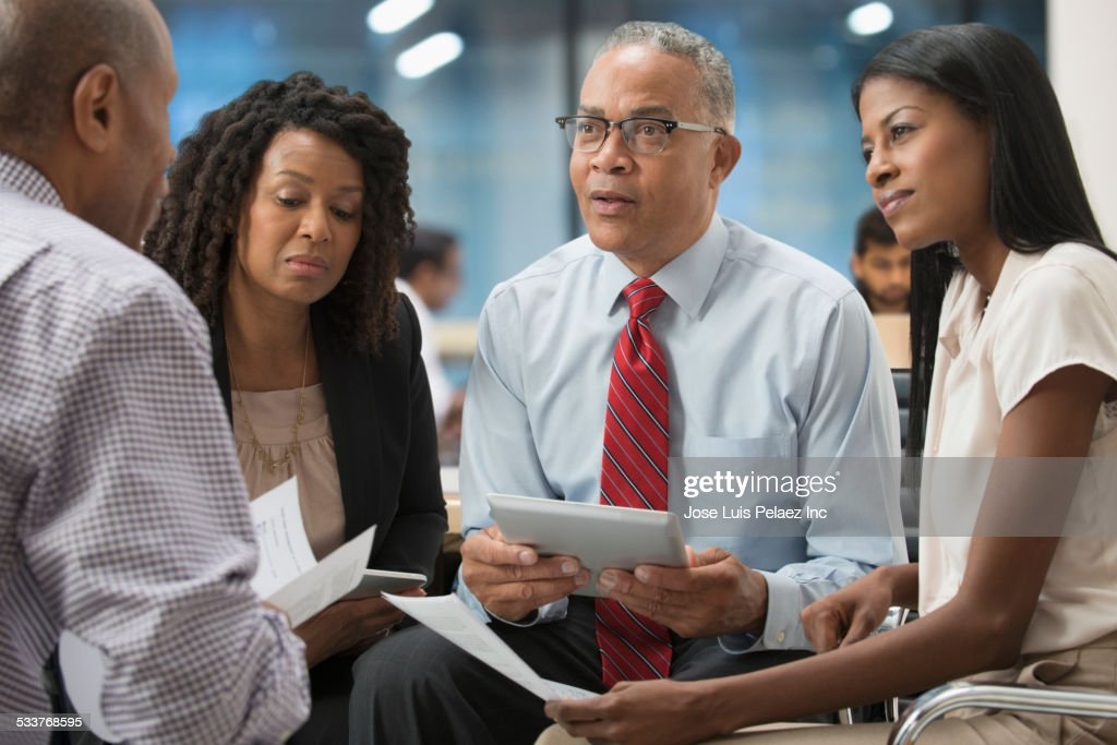 Business people using digital tablet in office meeting : Foto stock