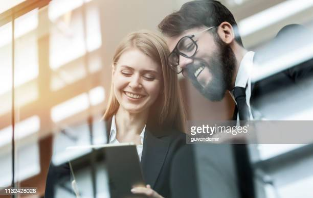 business people using digital tablet in office - economist stock pictures, royalty-free photos & images