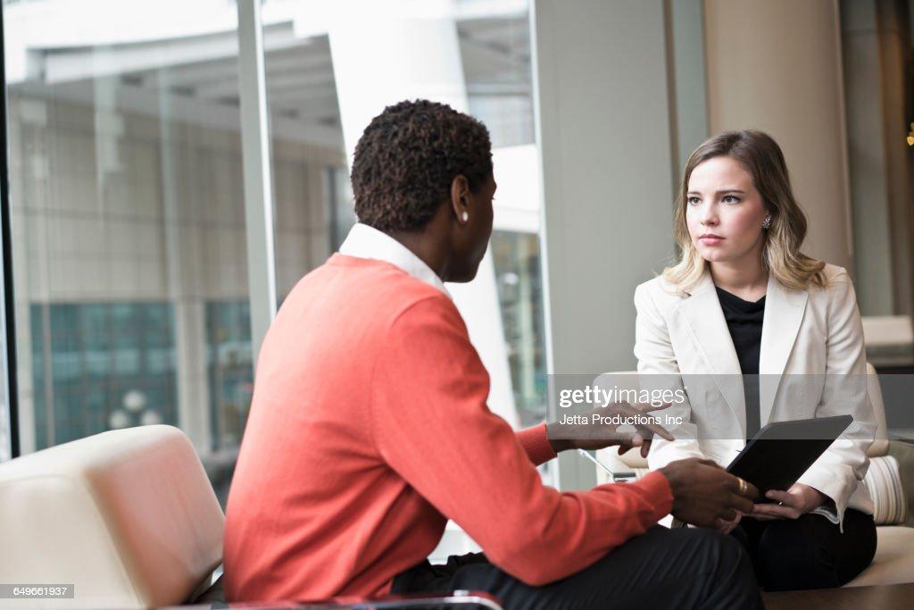 Business people using digital tablet in office : Stock-Foto