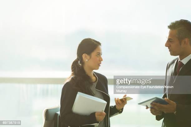 Business people using digital tablet in office