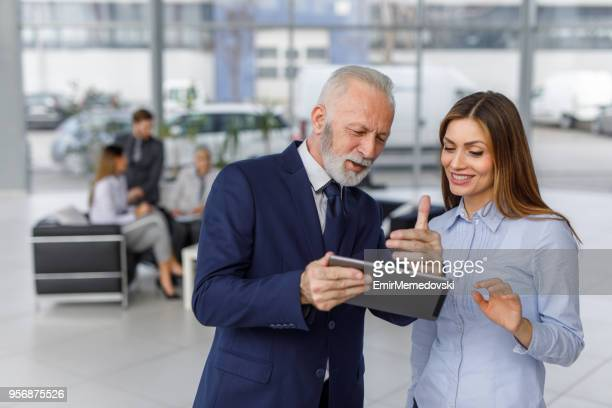 Business people using digital tablet looking for online data
