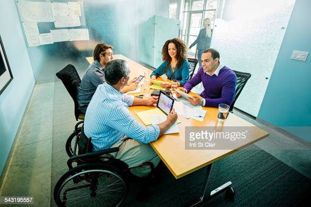 Business people using digital tablets in office meeting