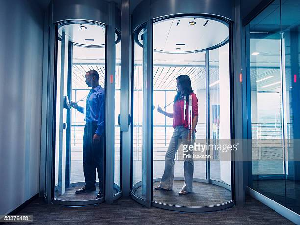 business people using fingerprint lock system in office - biometrics stock photos and pictures