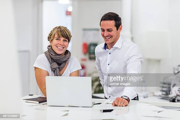 Business people using laptop, Stockholm, Sweden