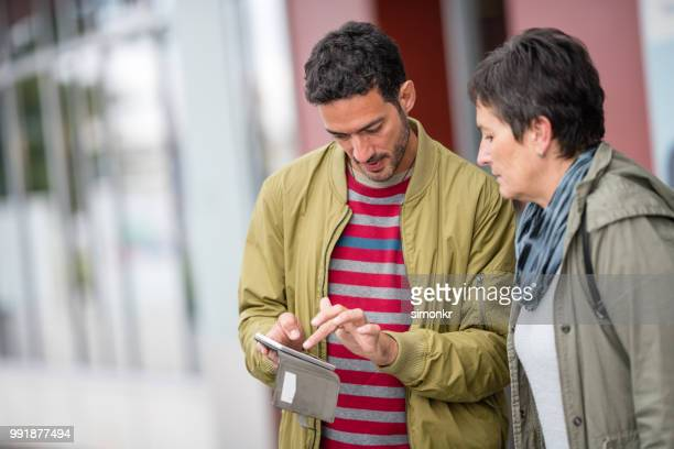 business people using mobile phone - khaki stock pictures, royalty-free photos & images