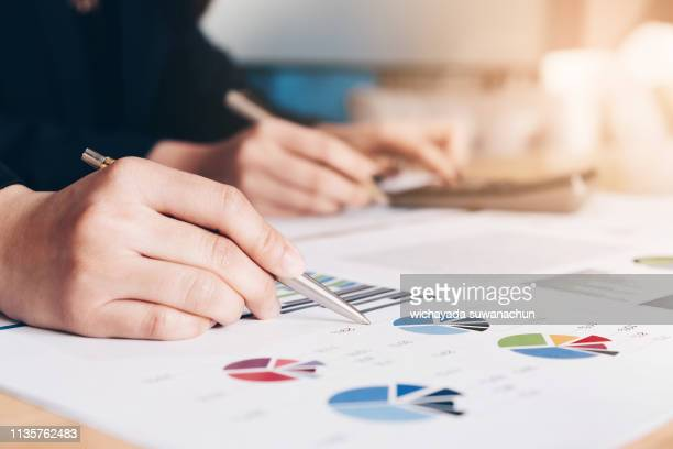 business people using pen are planning