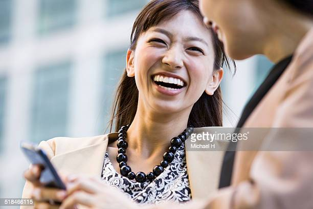 business people using smart phone outdoors - nur japaner stock-fotos und bilder