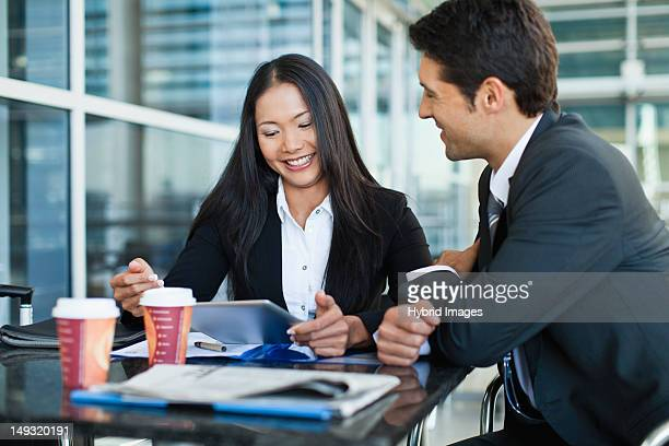 business people using tablet computer - ease stock pictures, royalty-free photos & images