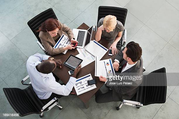 Business people using tablets and phones