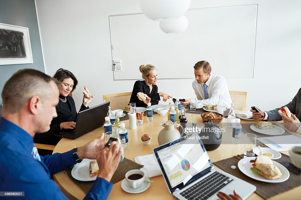 Business People Using Technology At Lunch Meeting Stock ...