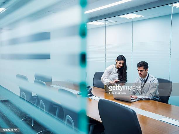 Business people using technology in conference room