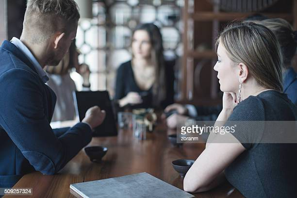 Business people using technologyt in restaurant
