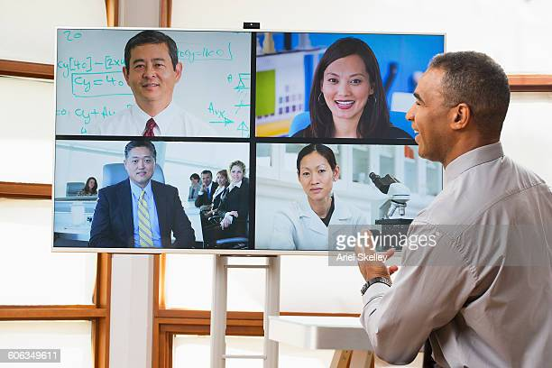 Business people video chatting in office