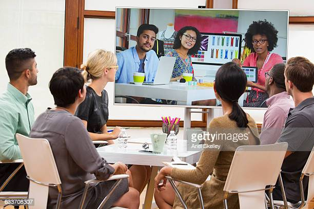 Business people video conferencing in meeting