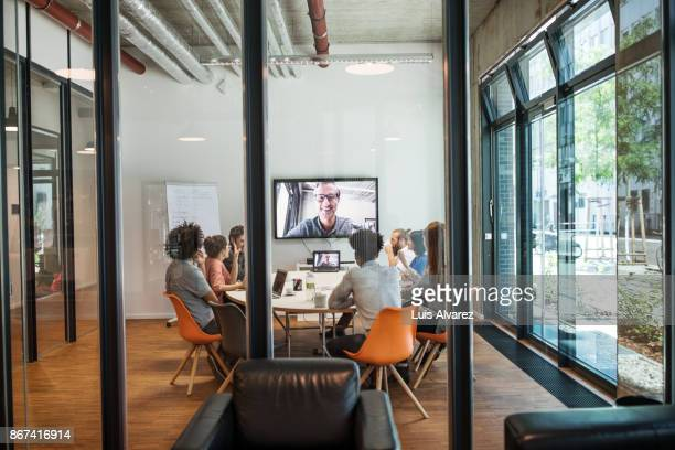 Business people video conferencing in meeting room