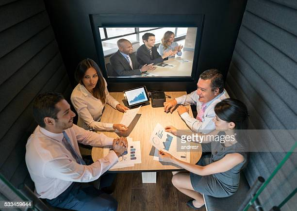 Business people videoconferencing