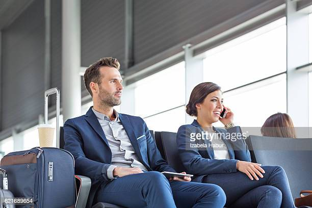 Business people waiting at airport longue