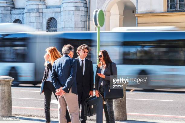 Business people waiting at bus station