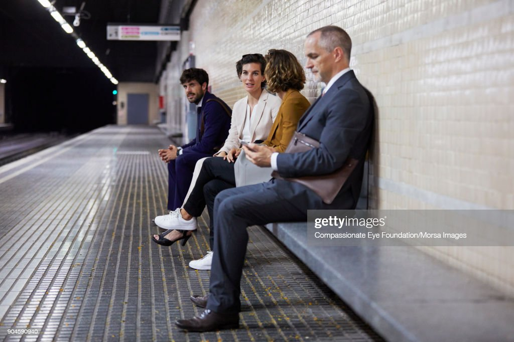 Business people waiting in subway station : Stock Photo