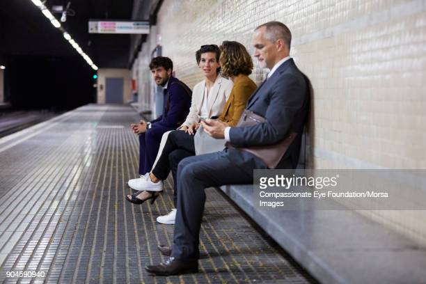 Business people waiting in subway station