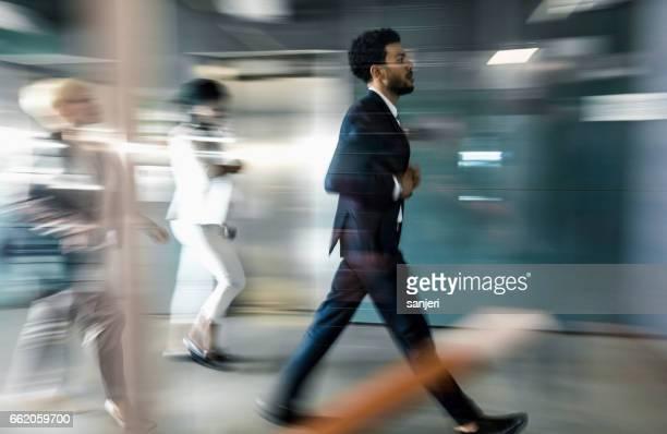 Business people walking along the corridor
