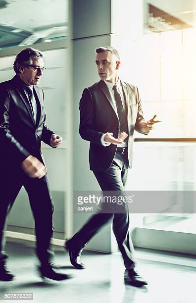 Business people walking at the lobby