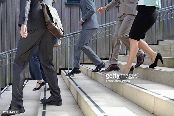business people walking down steps - dress shoe stock pictures, royalty-free photos & images