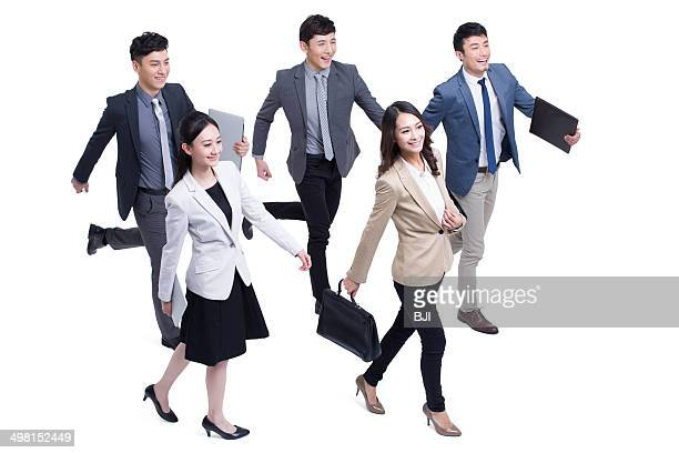 Business people walking forward confidently