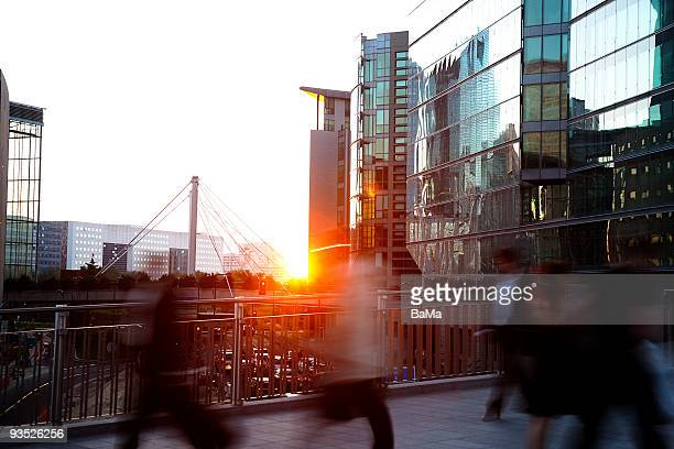 Business people walking home at sunset