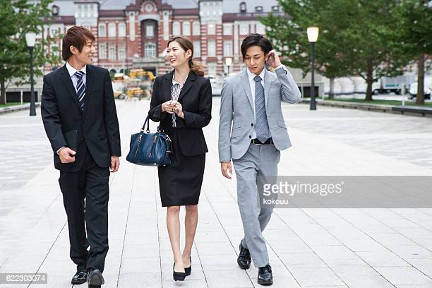 Business People Walking in a Fashionable Way