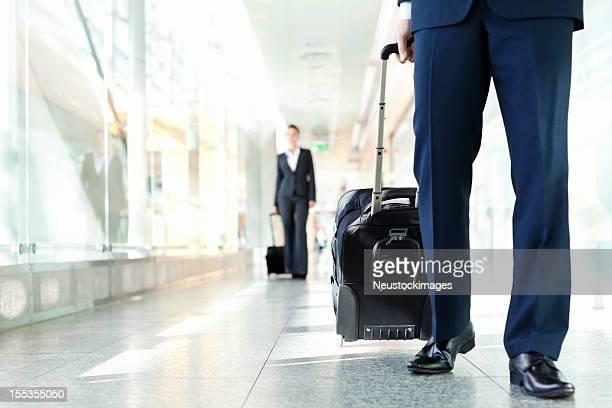 Business People Walking In Airport Hallway