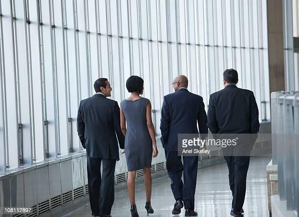 business people walking in corridor - abbigliamento da lavoro formale foto e immagini stock