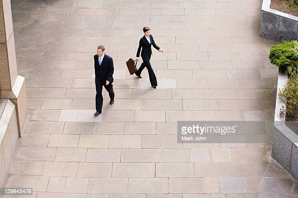 business people walking in courtyard - london court stock pictures, royalty-free photos & images