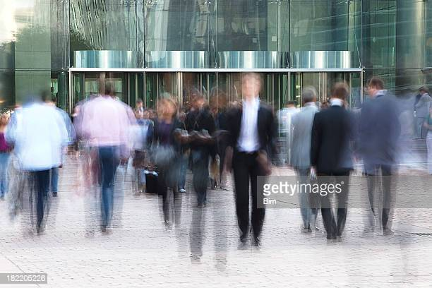 Business people walking in front of  an office building