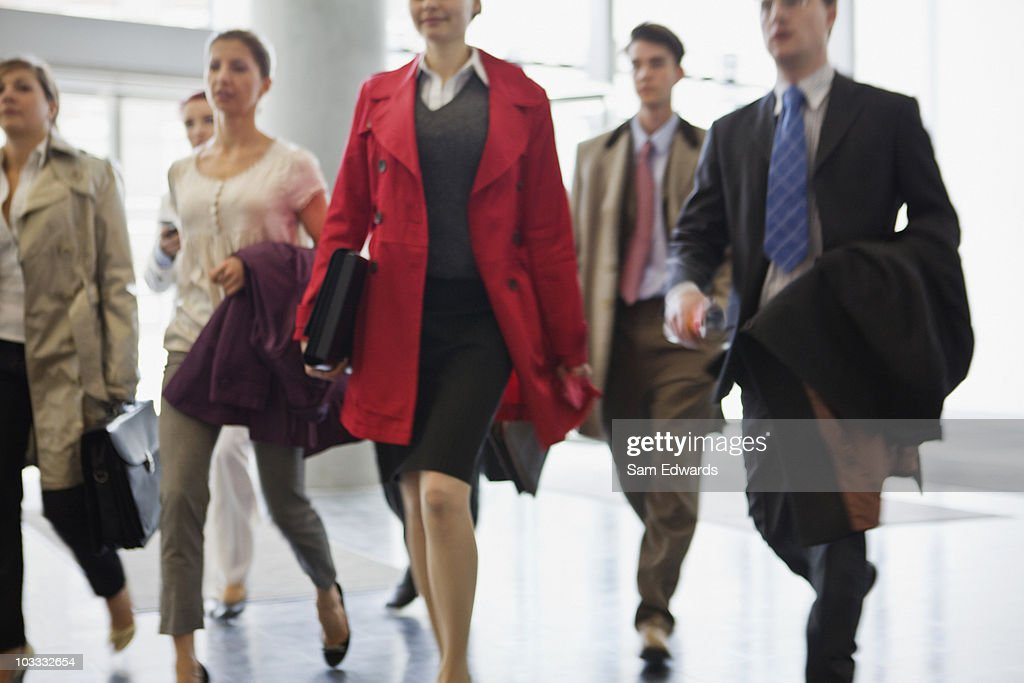 Business people walking in lobby : Stock Photo