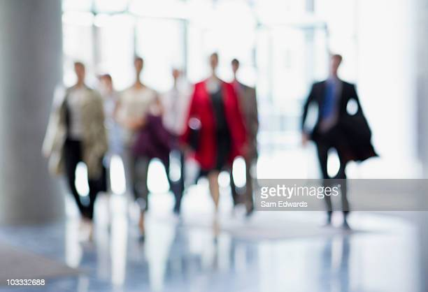 business people walking in lobby - arrival stock pictures, royalty-free photos & images
