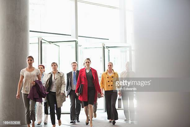 Business people walking in lobby
