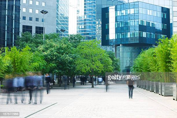 business people walking in modern financial district - groene kleuren stockfoto's en -beelden