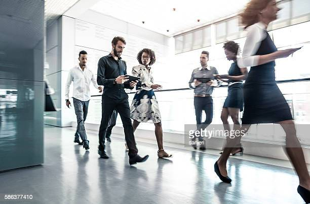 Business People Walking in the Lobby
