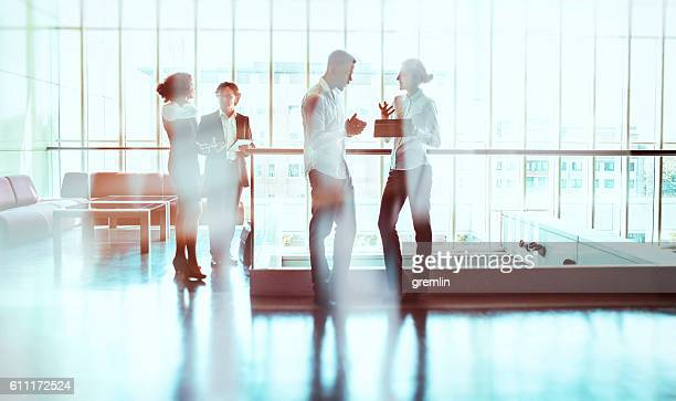 Business people walking in the office building lobby
